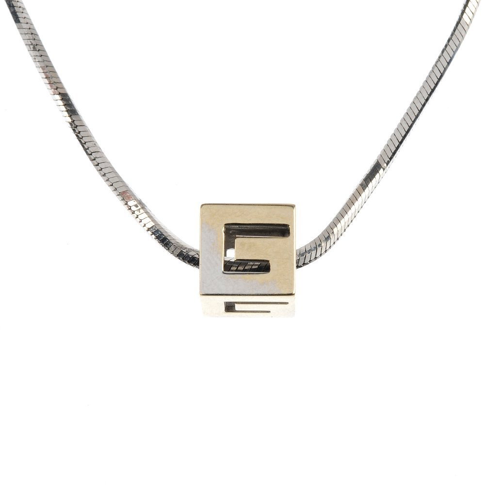 GUCCI - an abstract pendant.