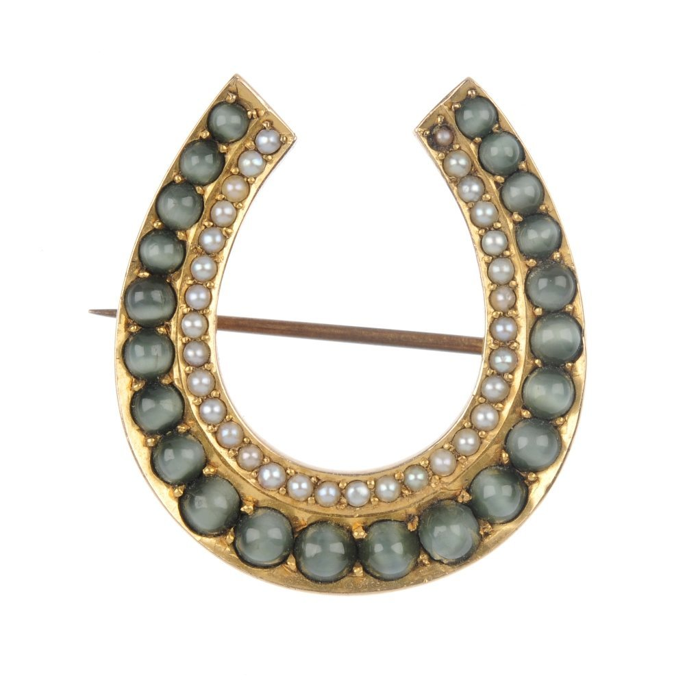 A late Victorian cat's-eye chrysoberyl horseshoe brooch