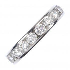 An 18ct gold diamond full-circle eternity ring.