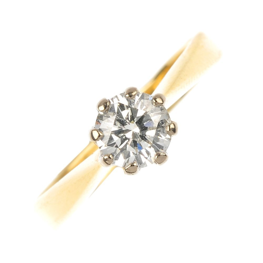 An 18ct gold diamond single-stone ring.