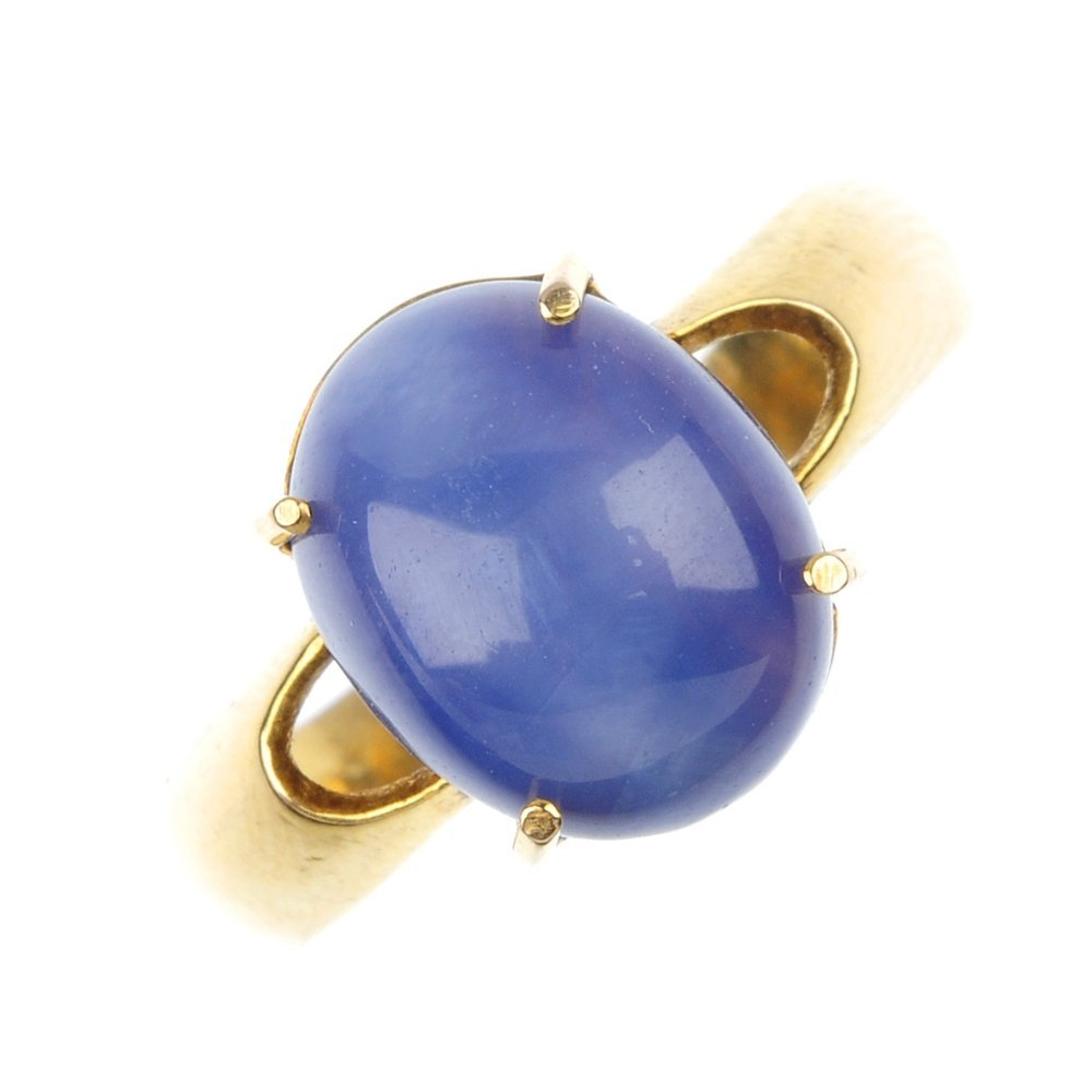 A synthetic star sapphire single-stone ring.