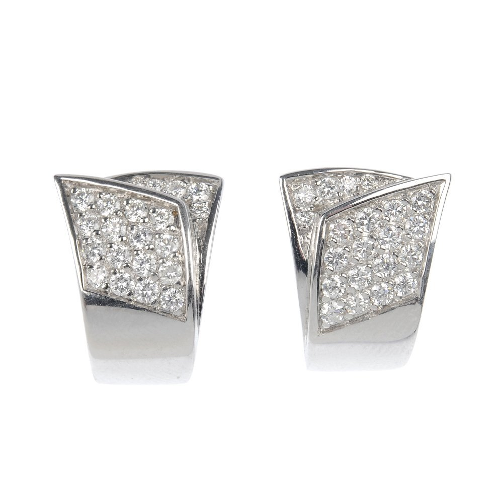 A pair of 18ct gold diamond earrings.