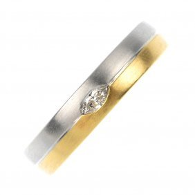 An 18ct gold and platinum diamond band ring.