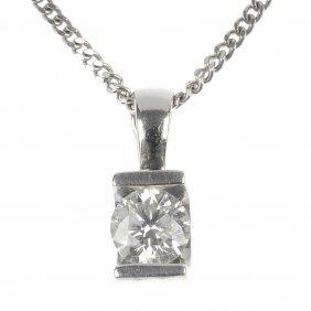 A 9ct gold diamond single-stone pendant.