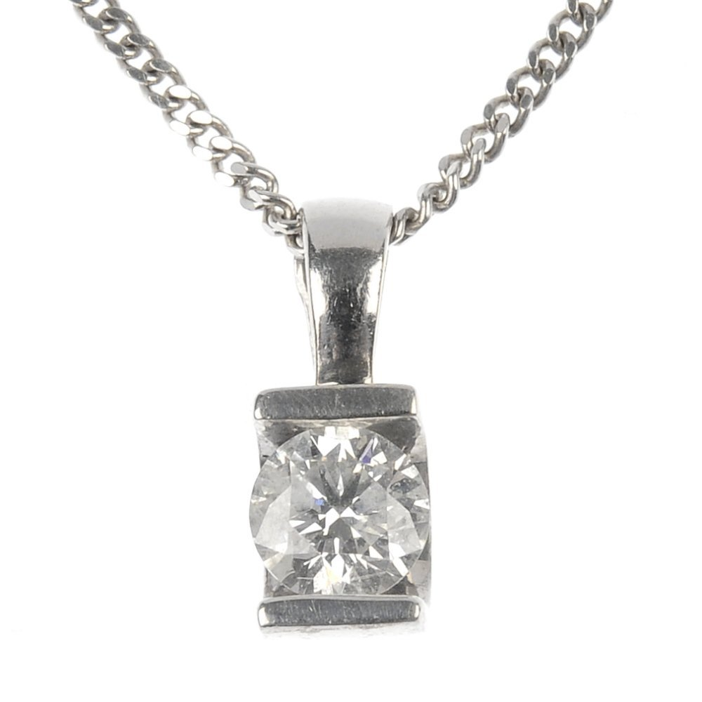 A 9ct gold diamond single-stone pendant.