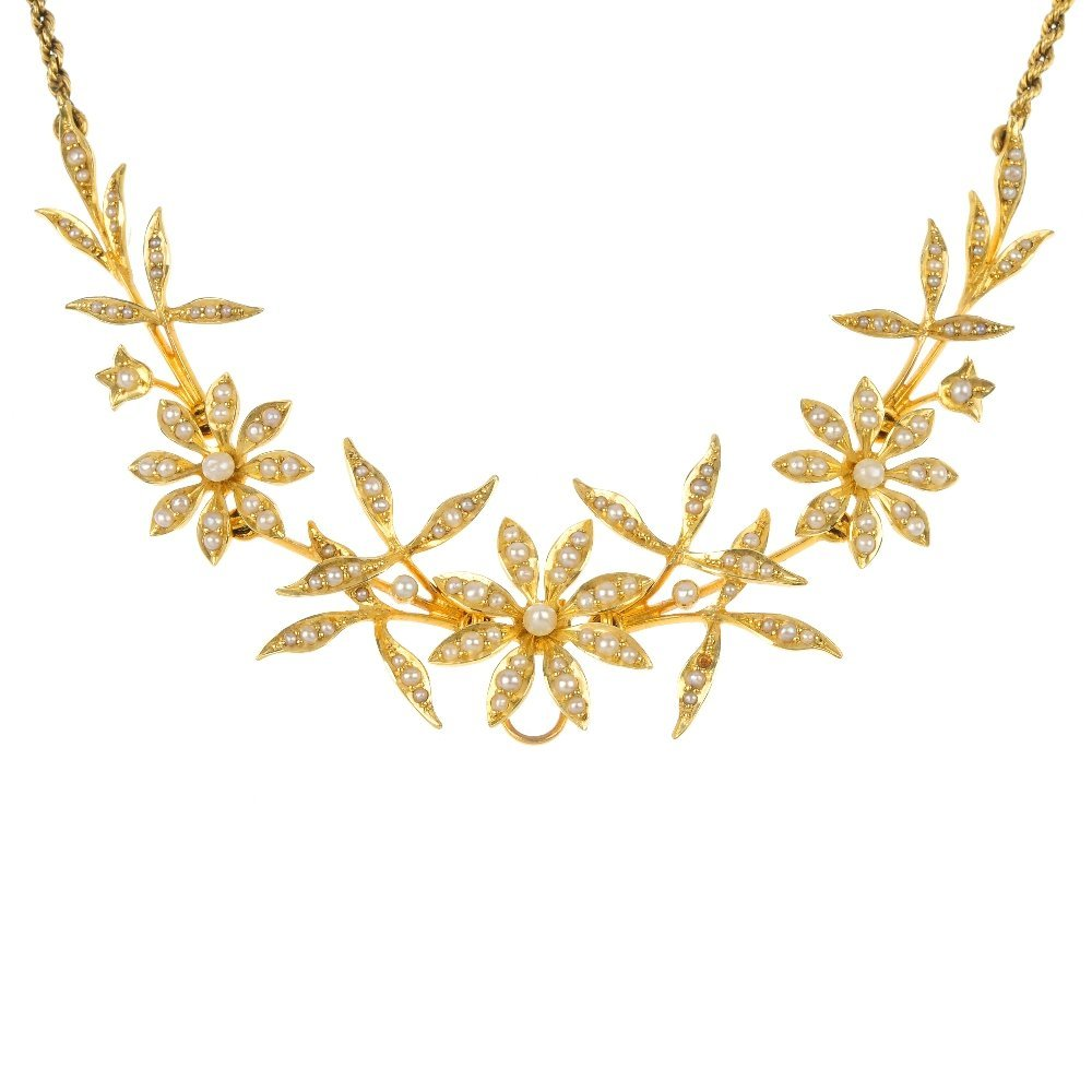 An early 20th century 15ct gold split pearl floral neck