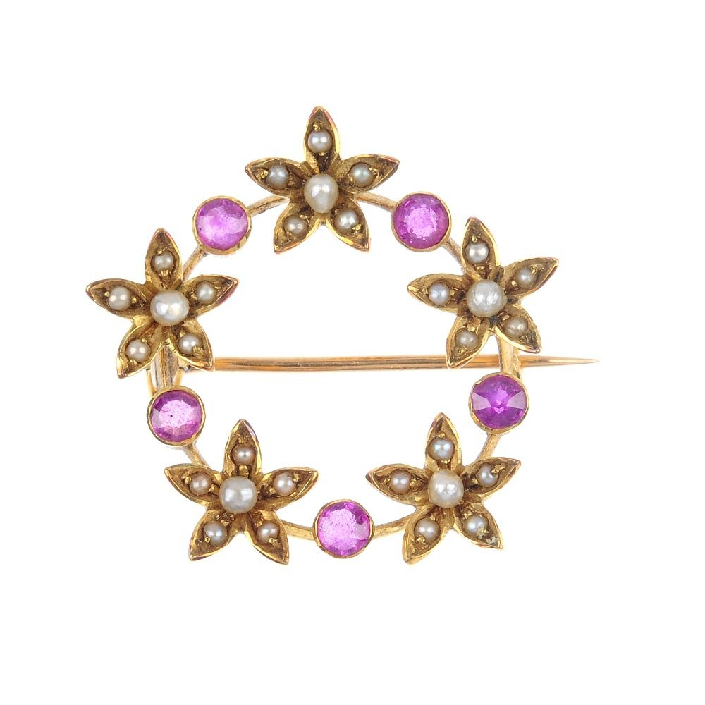 A mid 20th century 15ct gold ruby and seed pearl wreath