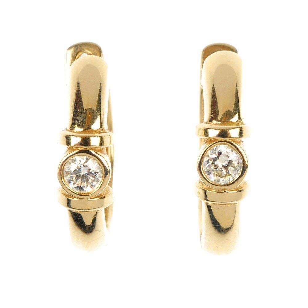 A pair of diamond ear hoops.