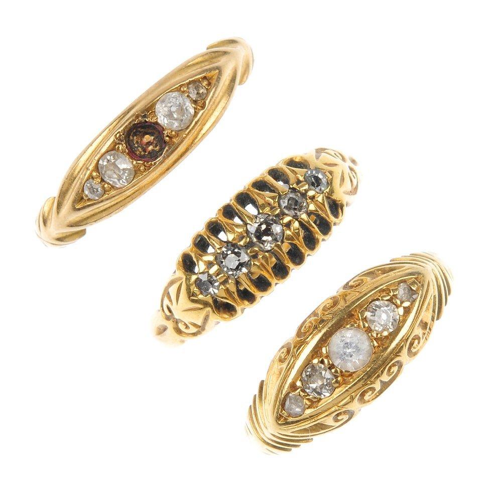 An assortment of three diamond five-stone rings.