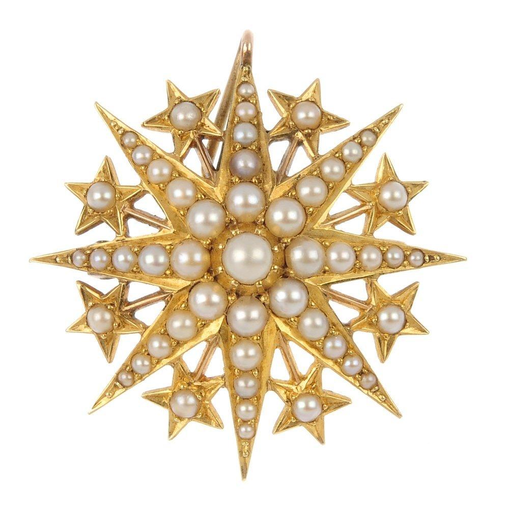 An early 20th century gold split pearl star brooch.