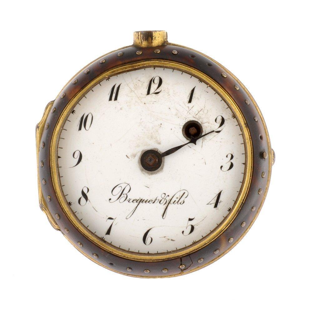 A gilt key wind open face pocket watch.