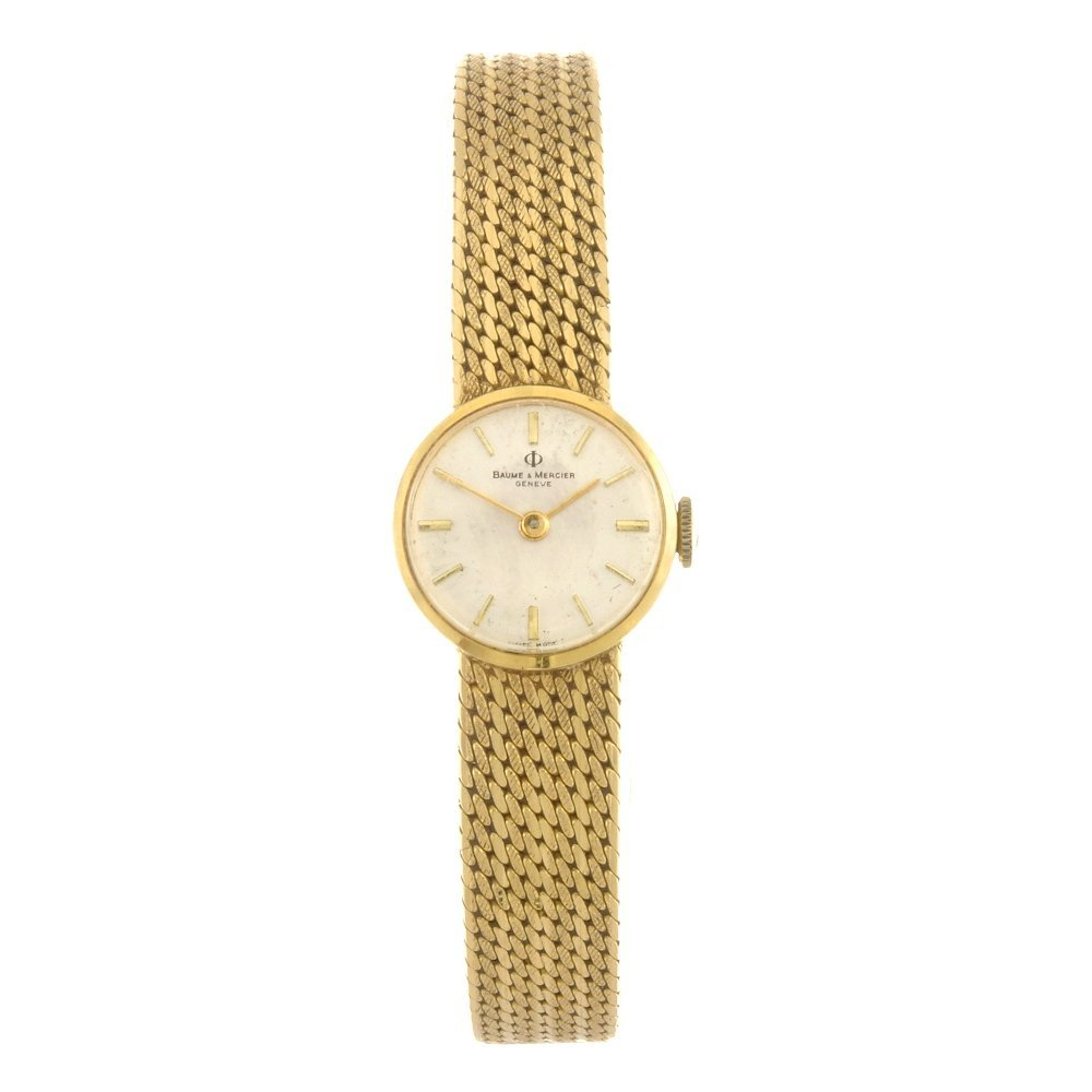 (808010773) An 18k gold manual wind lady's Baume & Merc