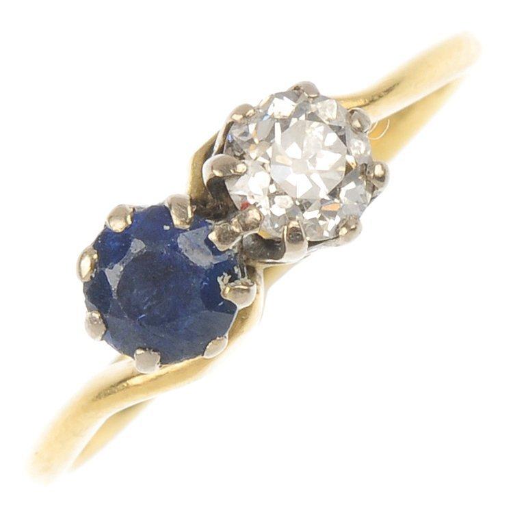 A mid 20th century 18ct gold diamond and sapphire cross