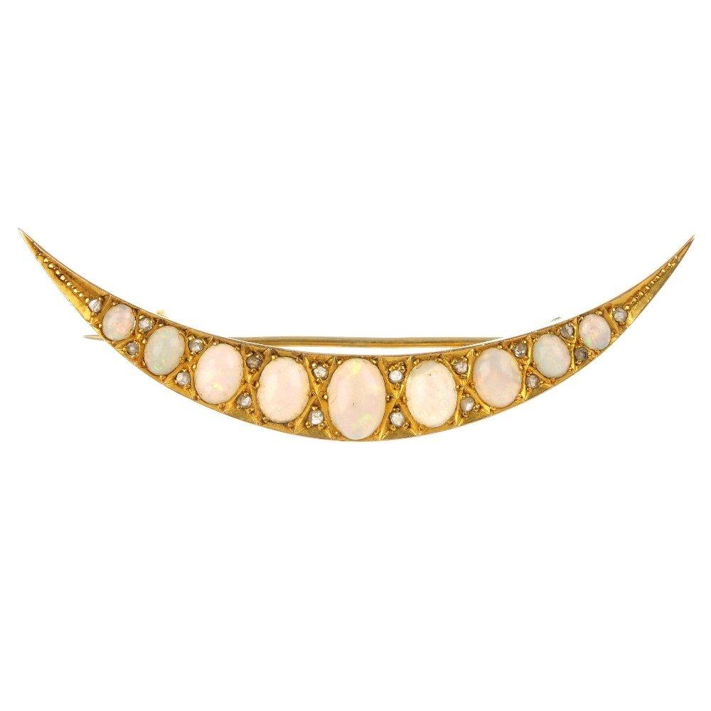 An opal and diamond crescent brooch.