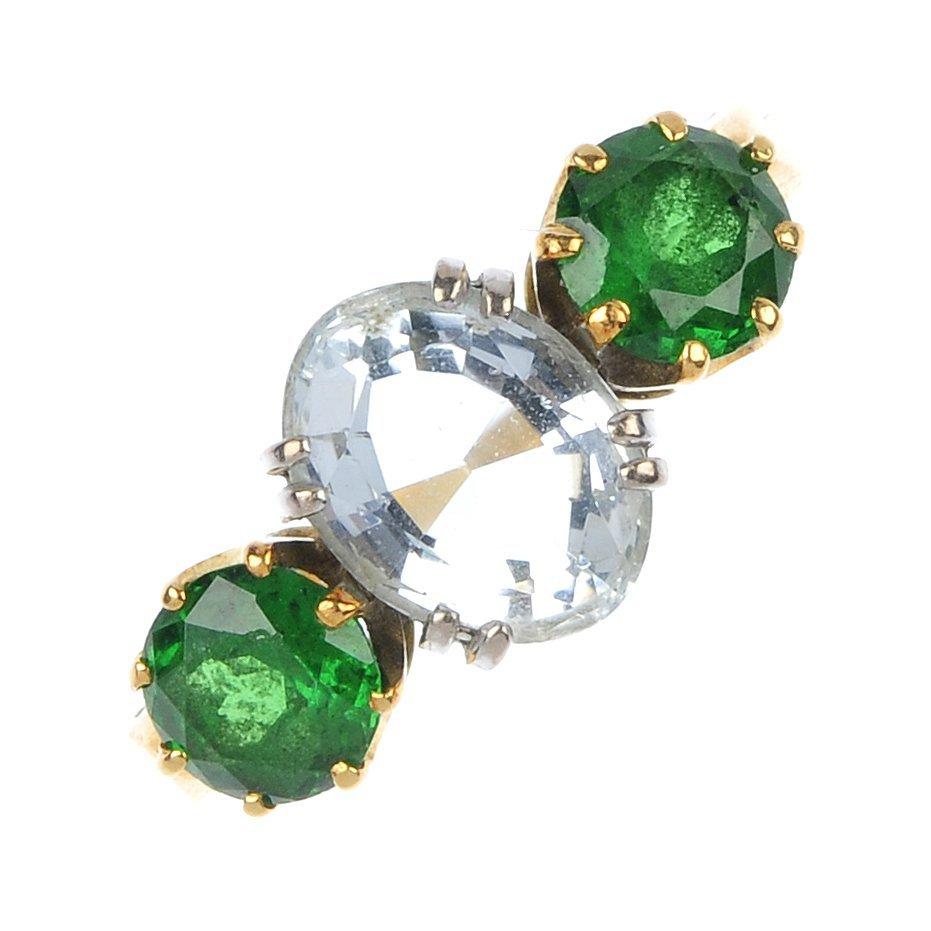 An 18ct gold aquamarine and garnet three-stone ring.
