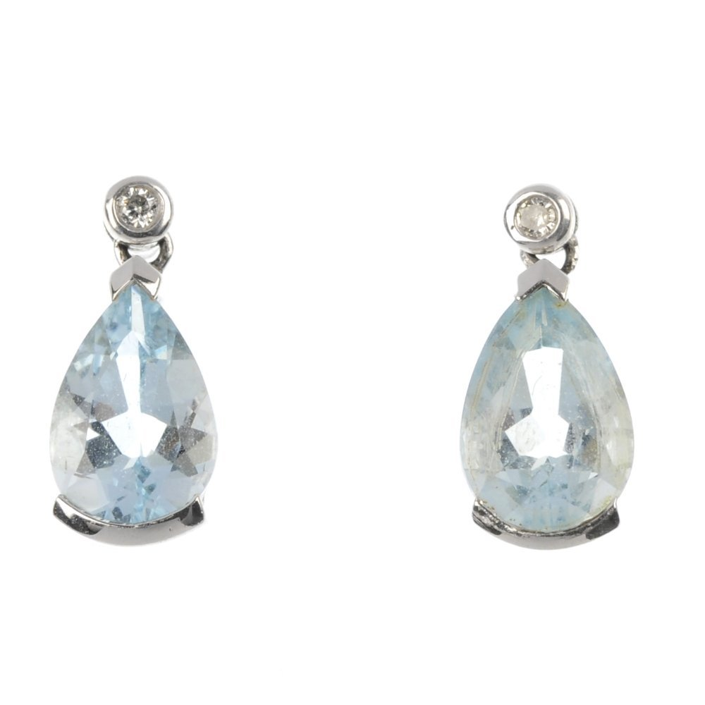 A pair of aquamarine and diamond earrings.