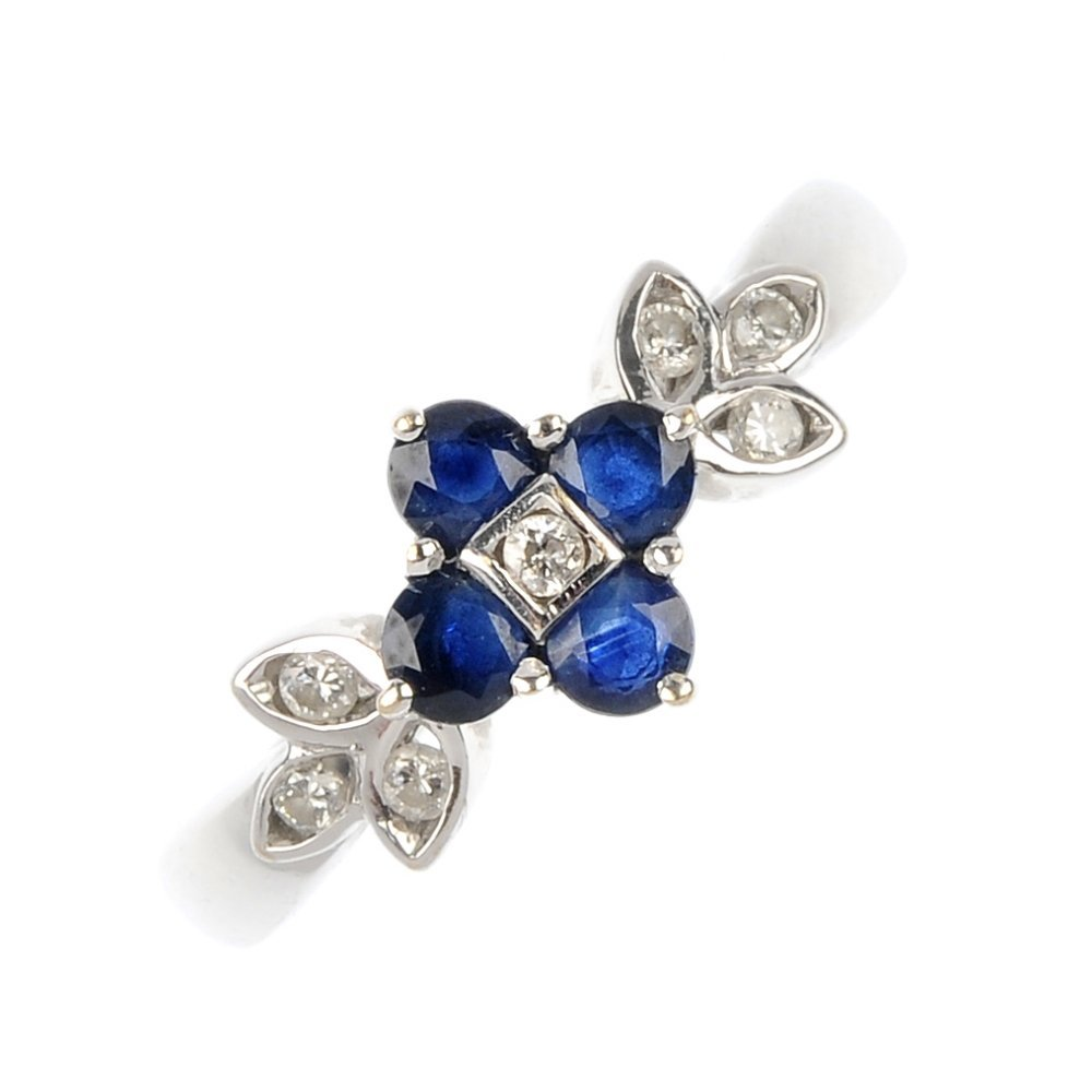 An 18ct gold sapphire and diamond floral ring.