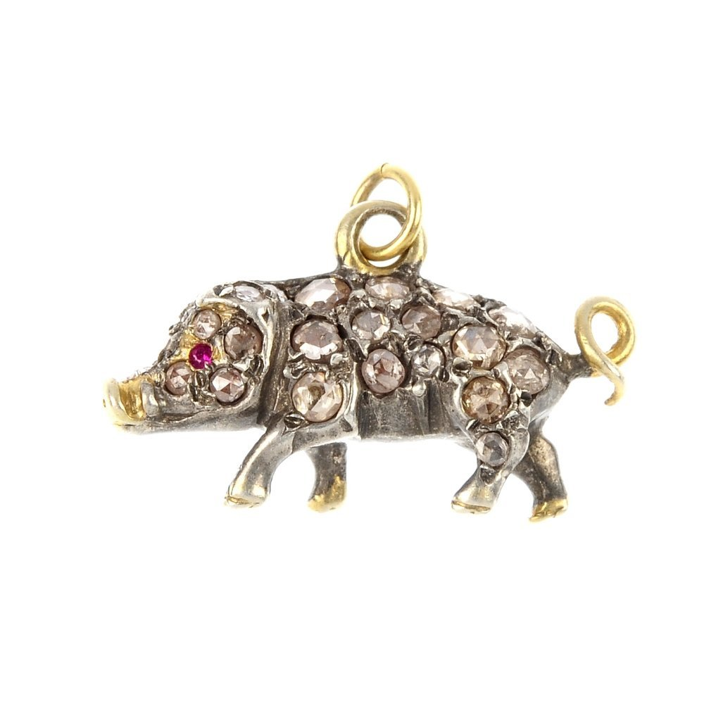 A diamond and ruby pig charm.