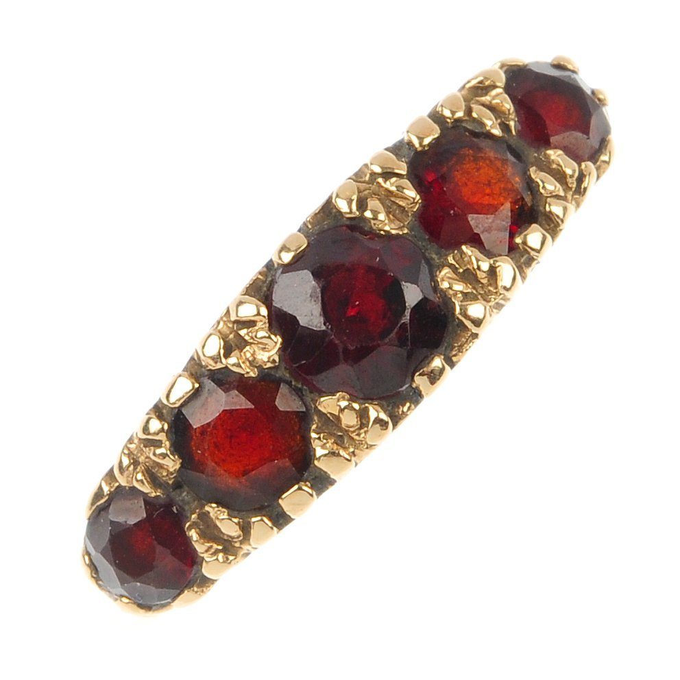 A 9ct gold garnet five-stone ring.