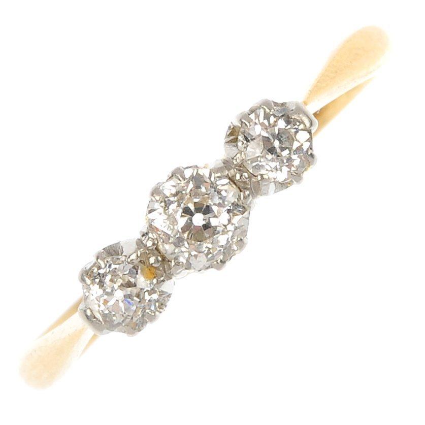 A mid 20th century 18ct gold and platinum diamond three