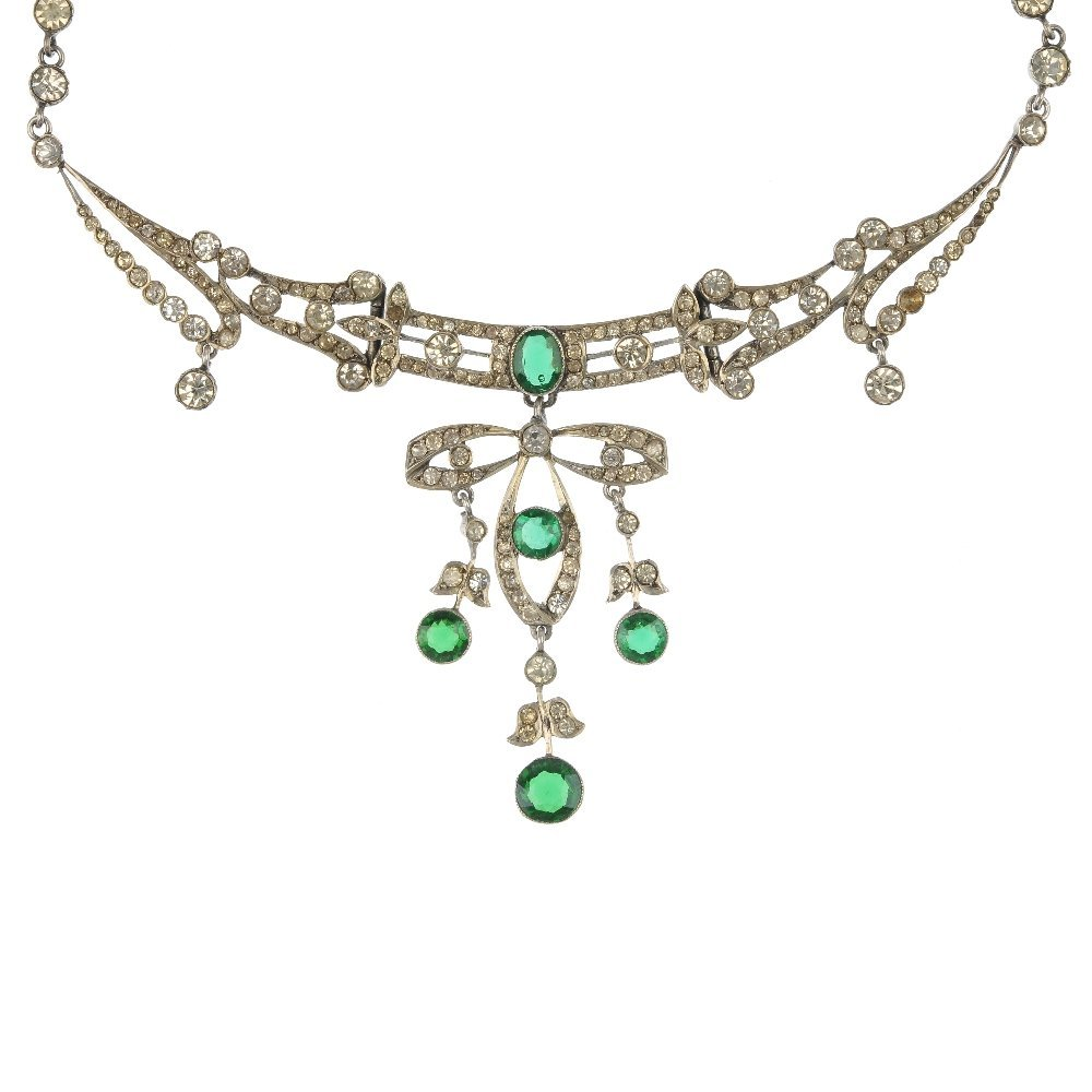 An early 20th century paste necklace of floral design.