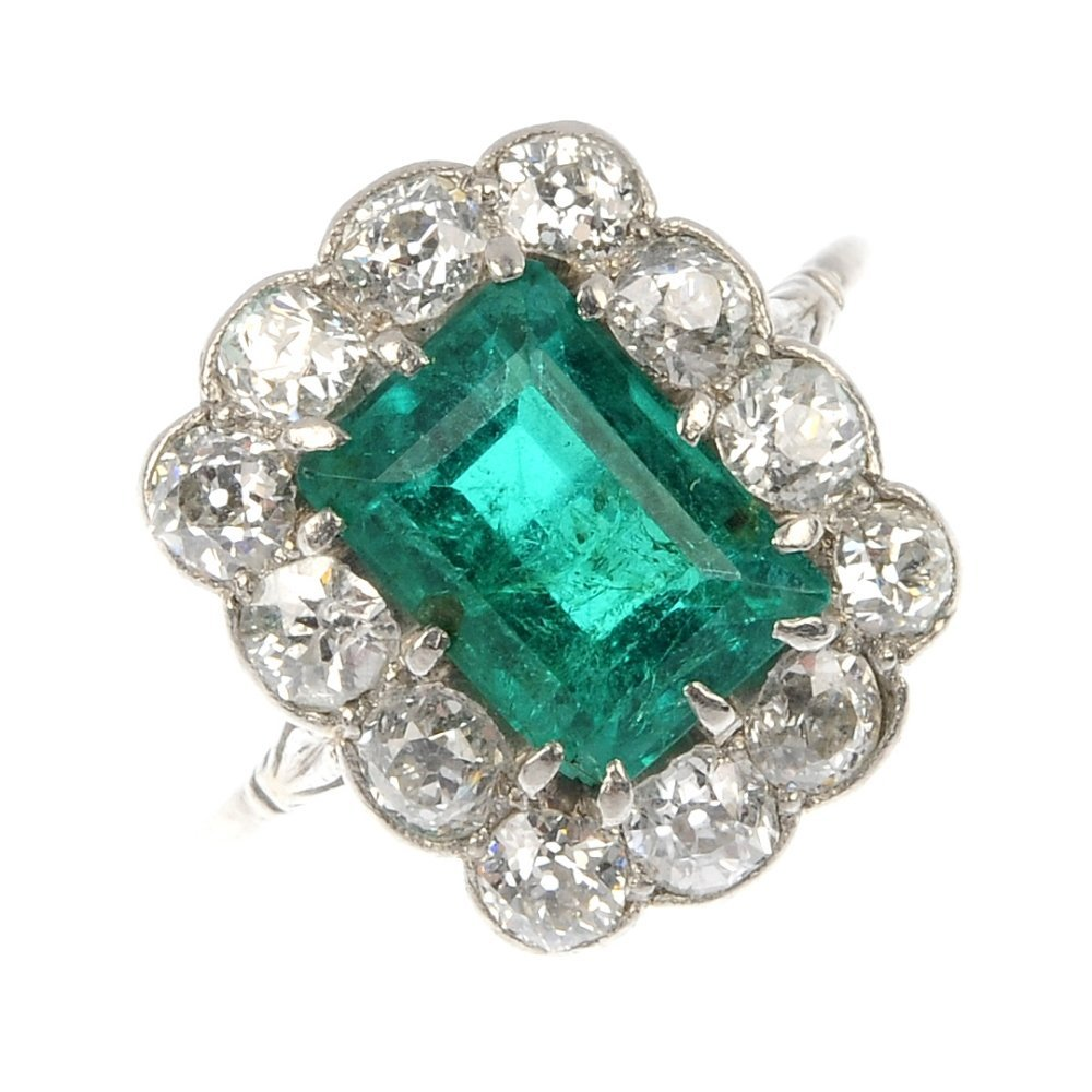 (527263-1-A) A mid 20th century platinum emerald and di