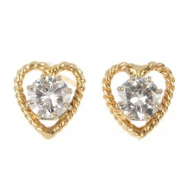 (527677-3-A) A pair of 9ct gold diamond ear studs.