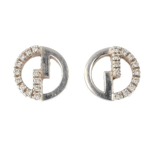 GUCCI - a pair of 18ct gold diamond ear studs.