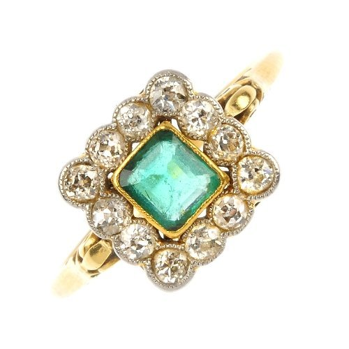 A mid 20th century gold emerald and diamond cluster rin