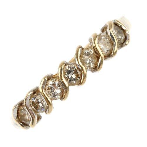 BOODLES & DUNTHORNE - an 18ct gold diamond half eternit