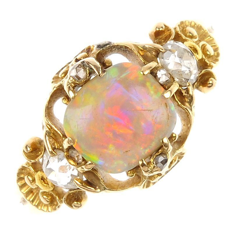 A late 19th century gold opal and diamond ring.