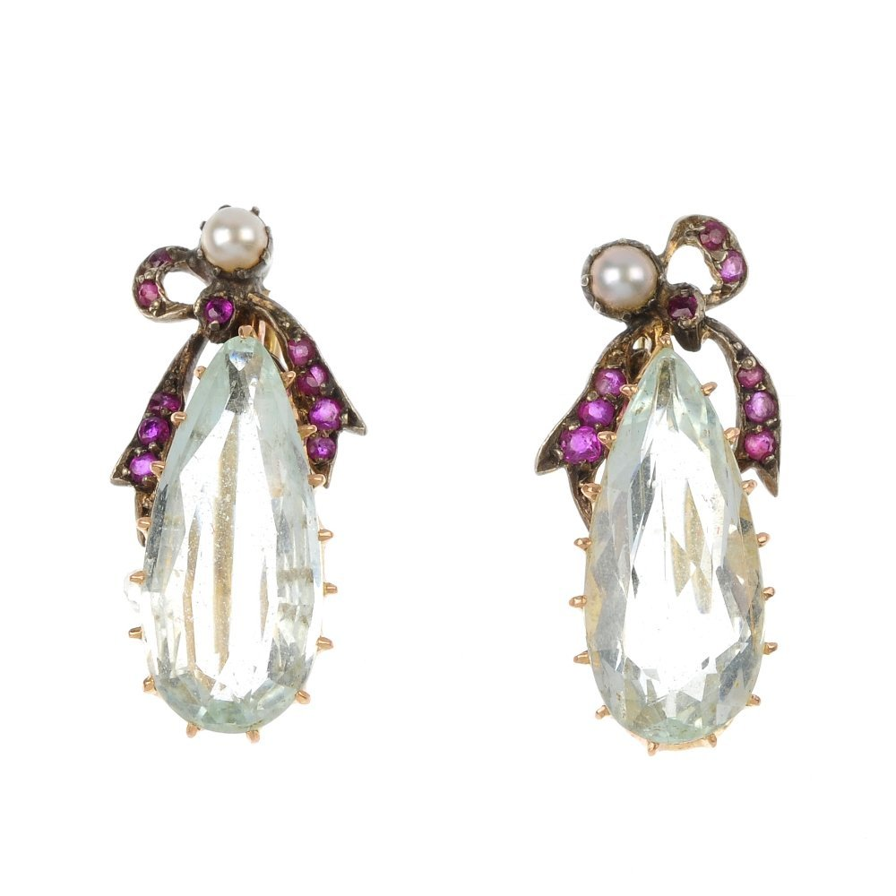 A pair of aquamarine and ruby earrings.