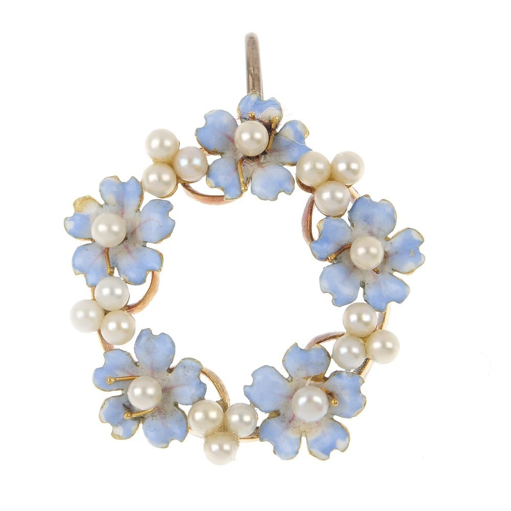 An early 20th century gold seed pearl and enamel floral
