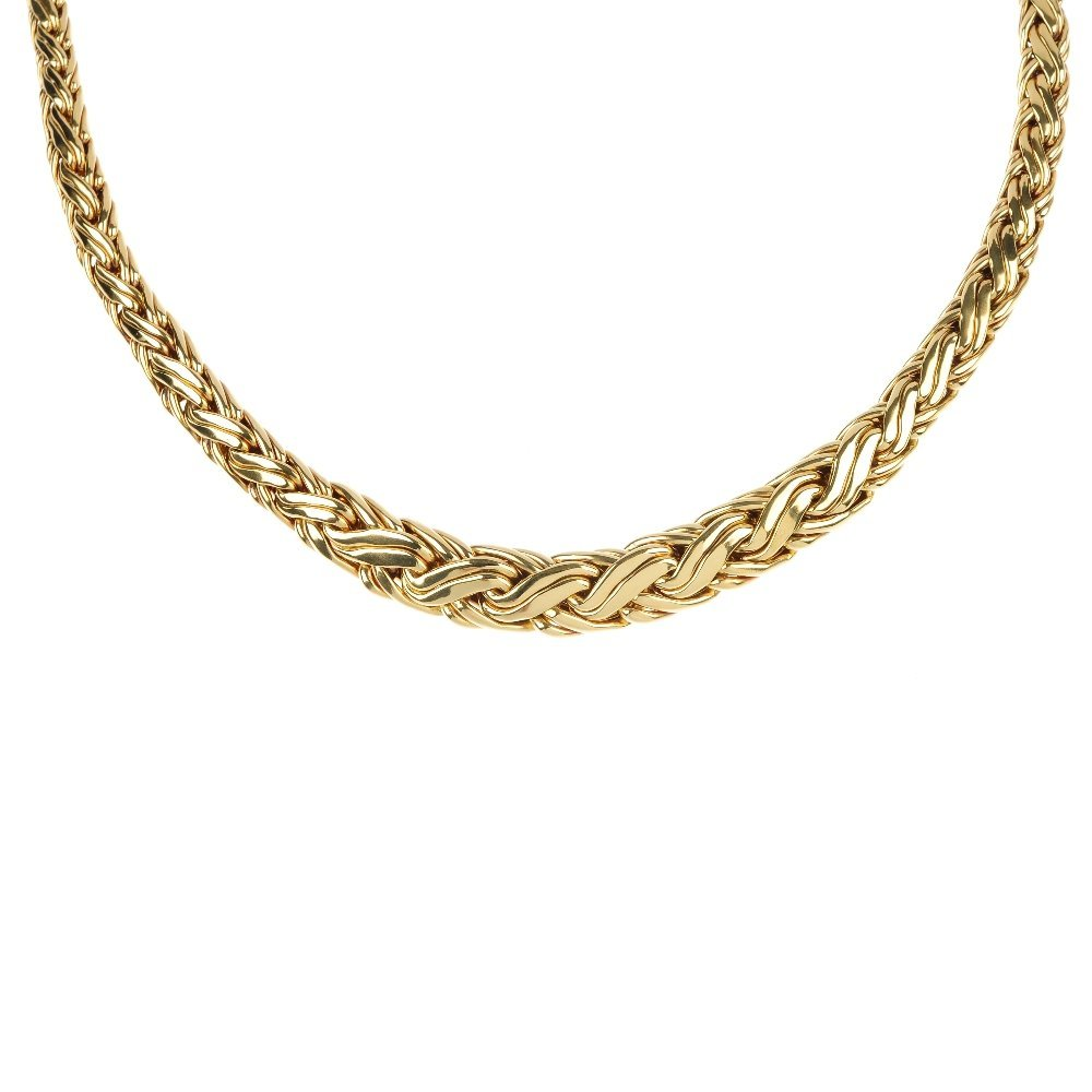 TIFFANY & CO. - an 18ct gold woven necklace.
