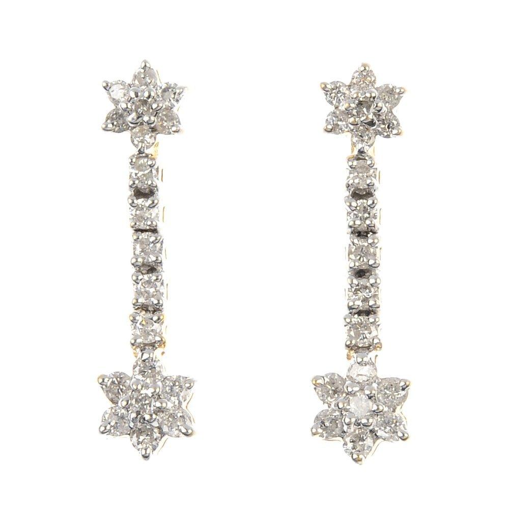 A pair of 18ct gold diamond ear pendants.