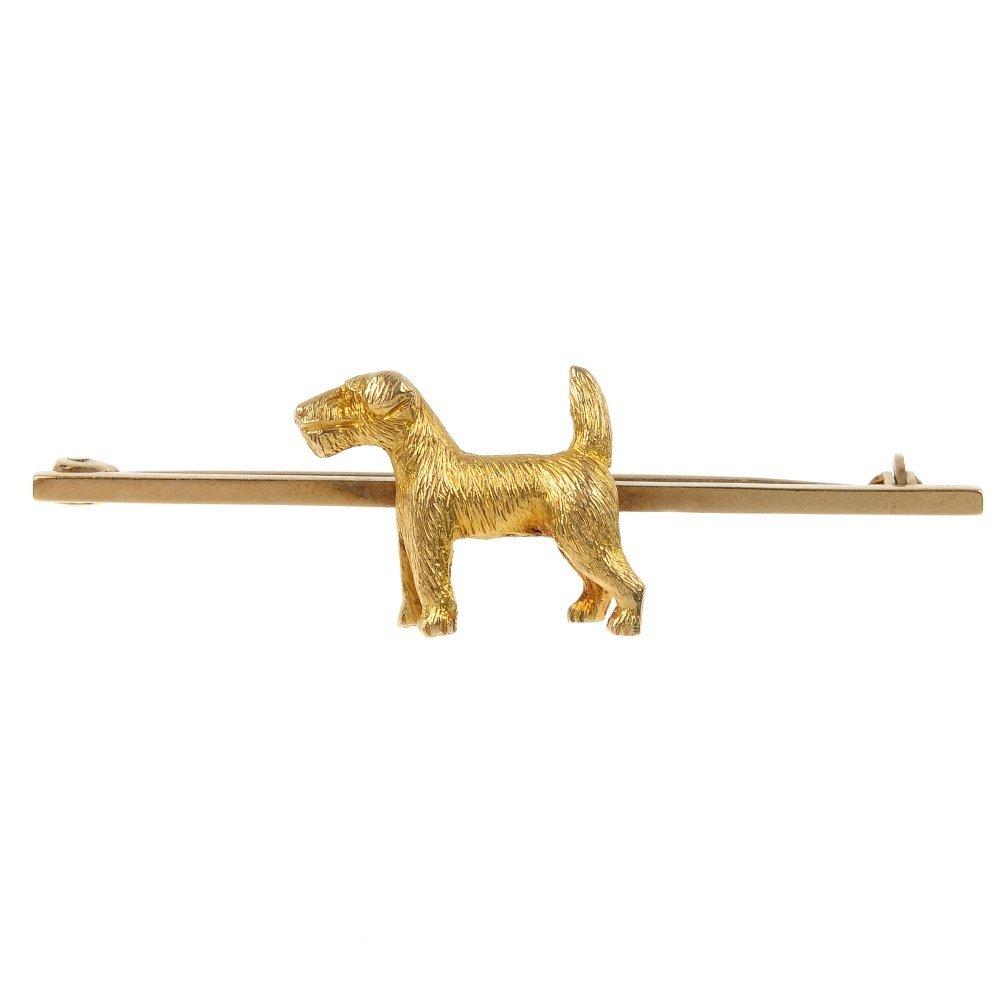 A 1950s 9ct gold terrier bar brooch.