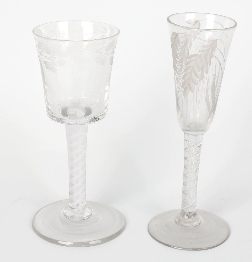 A glass with flared conical bowl and a similar example