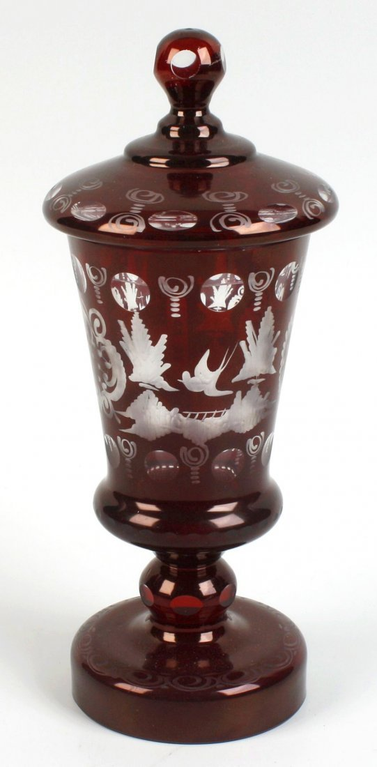 A Bohemian ruby flashed vase and cover