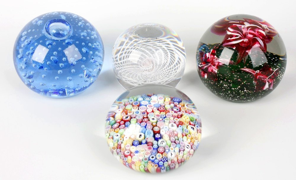 Four paperweights to include a modern Baccarat example