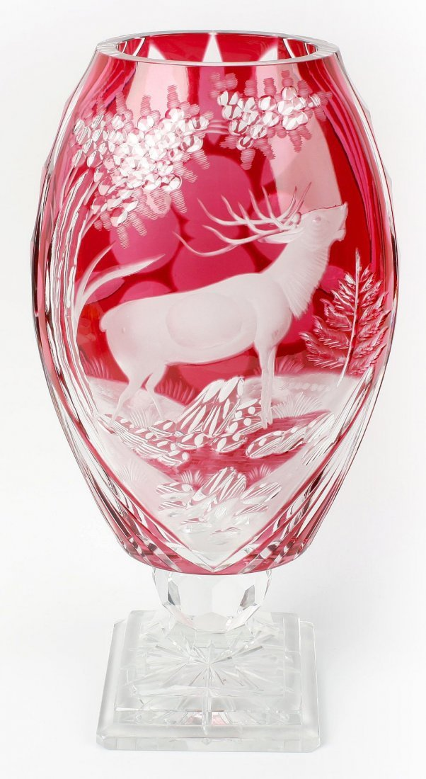 A large Bohemian-style ruby-flashed glass vase
