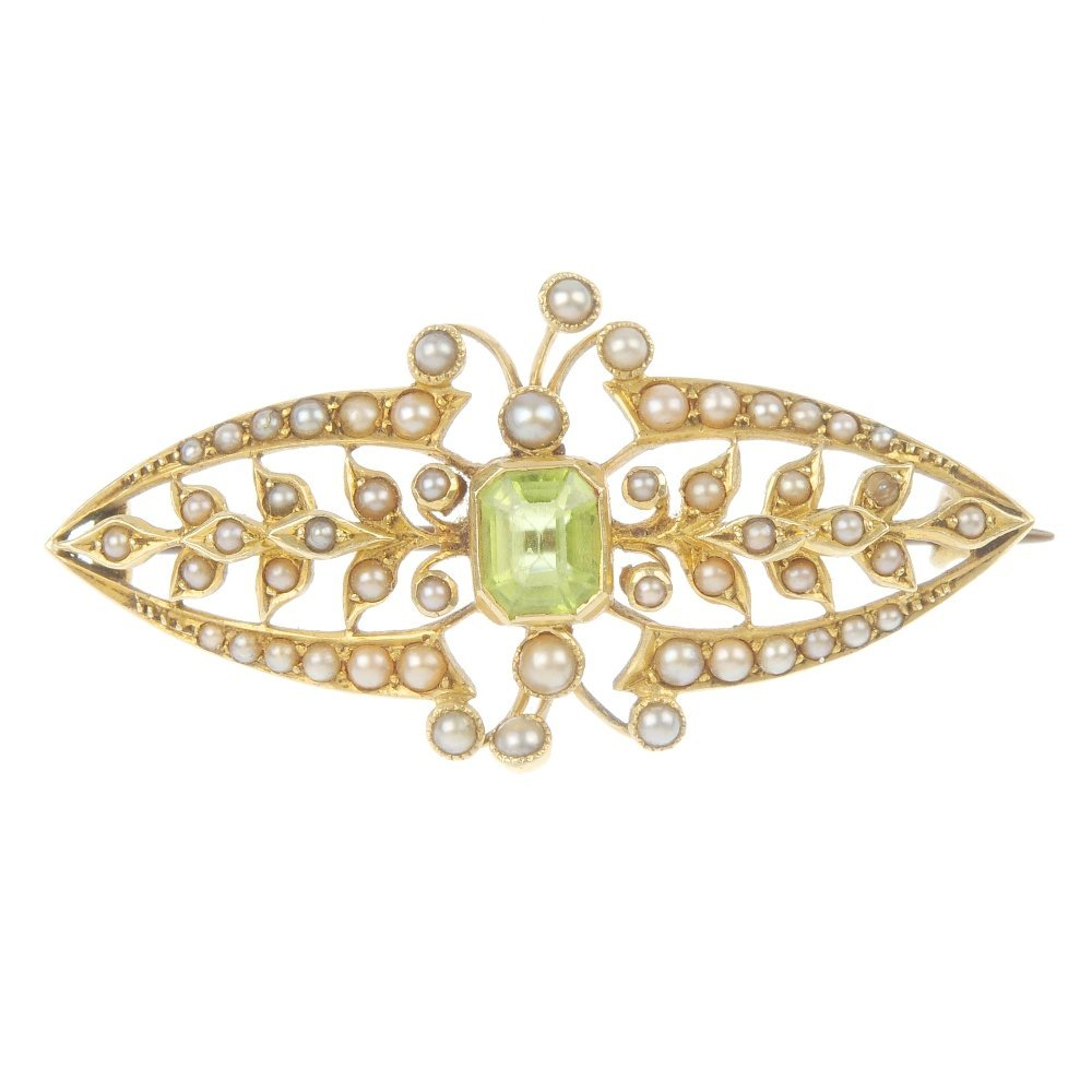A mid 20th century 15ct gold peridot and seed pearl bro