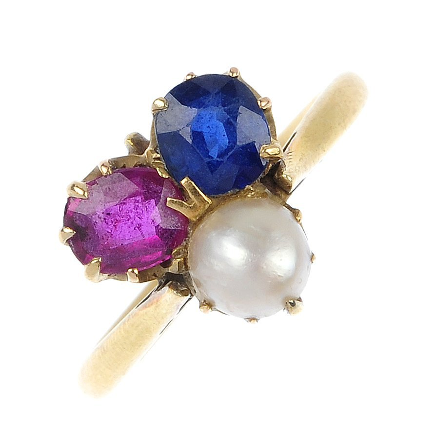 An early 20th century ruby, sapphire and split pearl ri