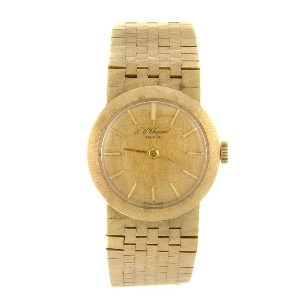 An 18k gold manual wind lady's Chopard bracelet watch.