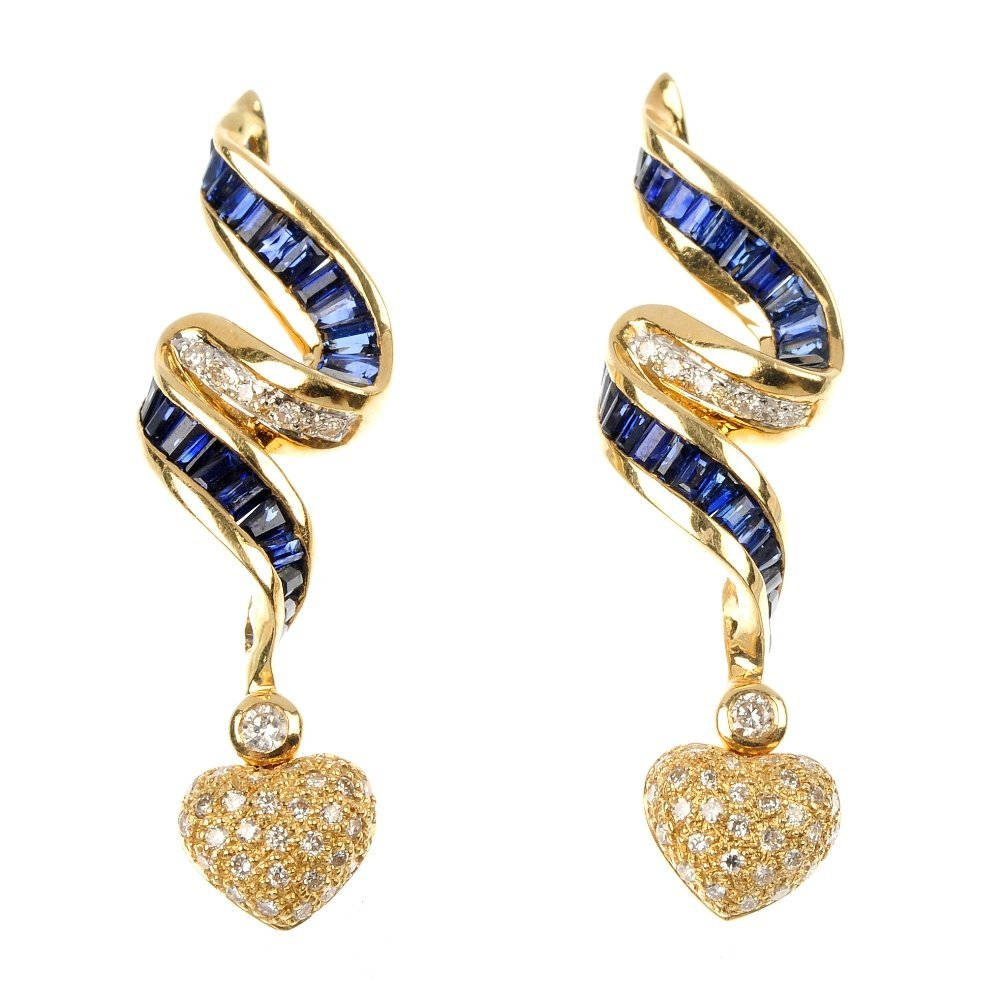 A pair of diamond and sapphire ear pendants.