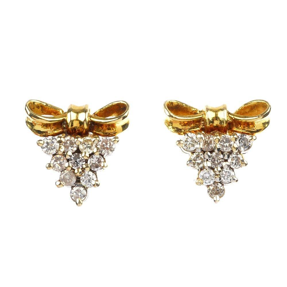 A pair diamond cluster earrings.