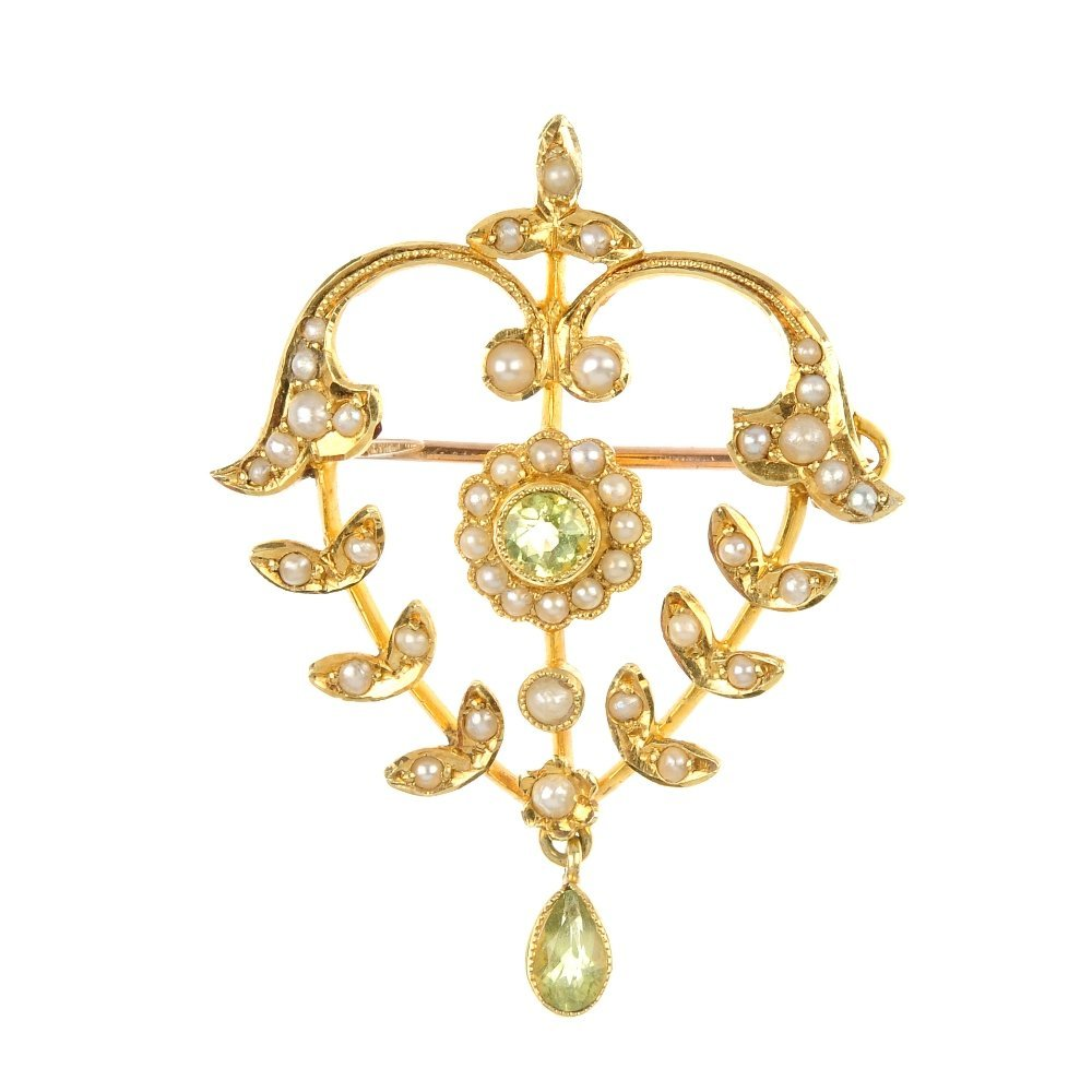 An early 20th century 15ct gold gem-set brooch.