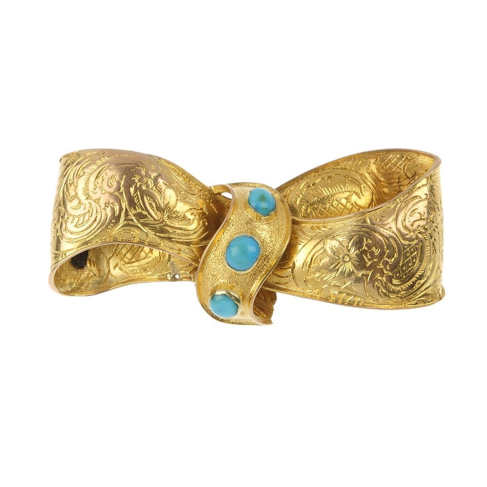 A late 19th century gold turquoise bow brooch
