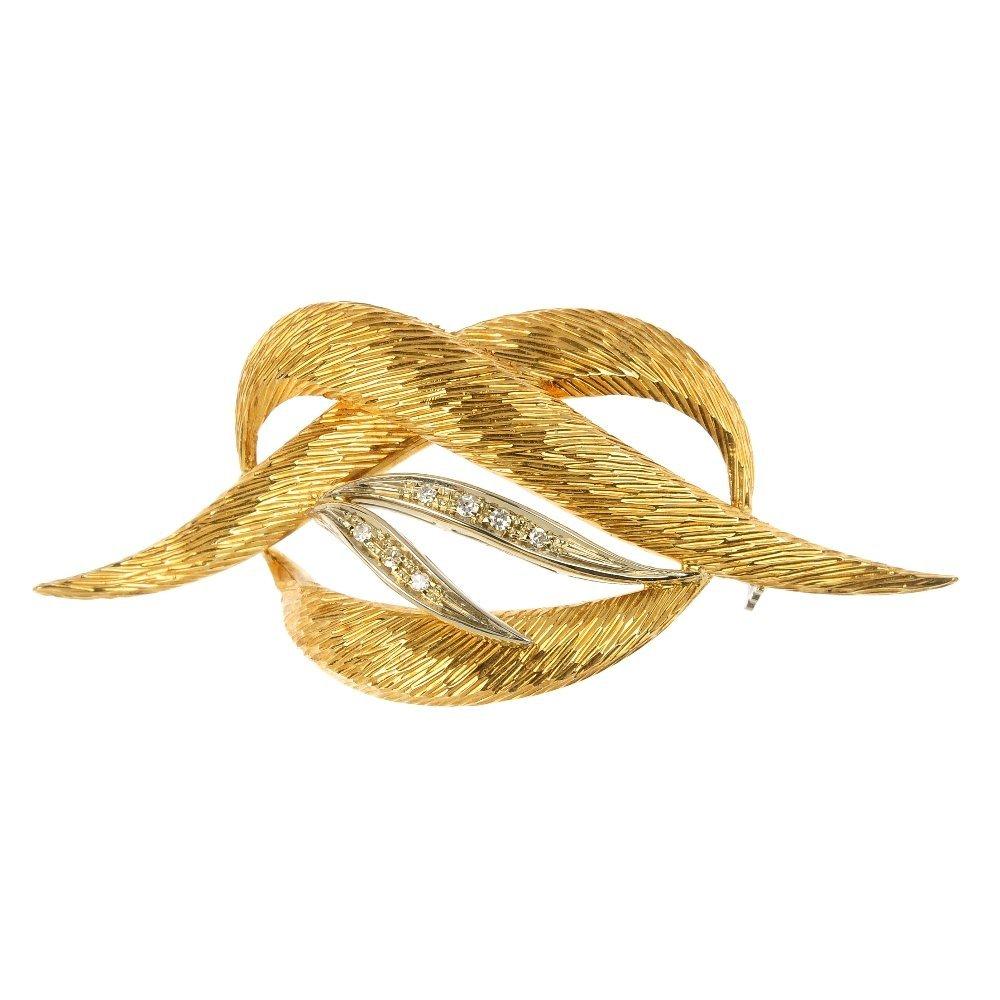An 18ct gold diamond knot brooch.