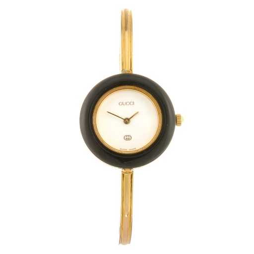 f9a4944fff6 A gold plated quartz lady s Gucci 11 12 bangle watch.