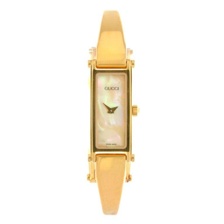 5a43e0463e698 A gold plated quartz lady's Gucci 1500 bracelet watch. - Apr 15 ...
